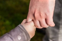 Child trusting His Dad by holding his hand