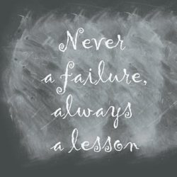 "Chalkboard with white chalk written ""Never a failure, always a lesson"""